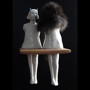 """Find the lady with one furry head"" porcelain unique piece"